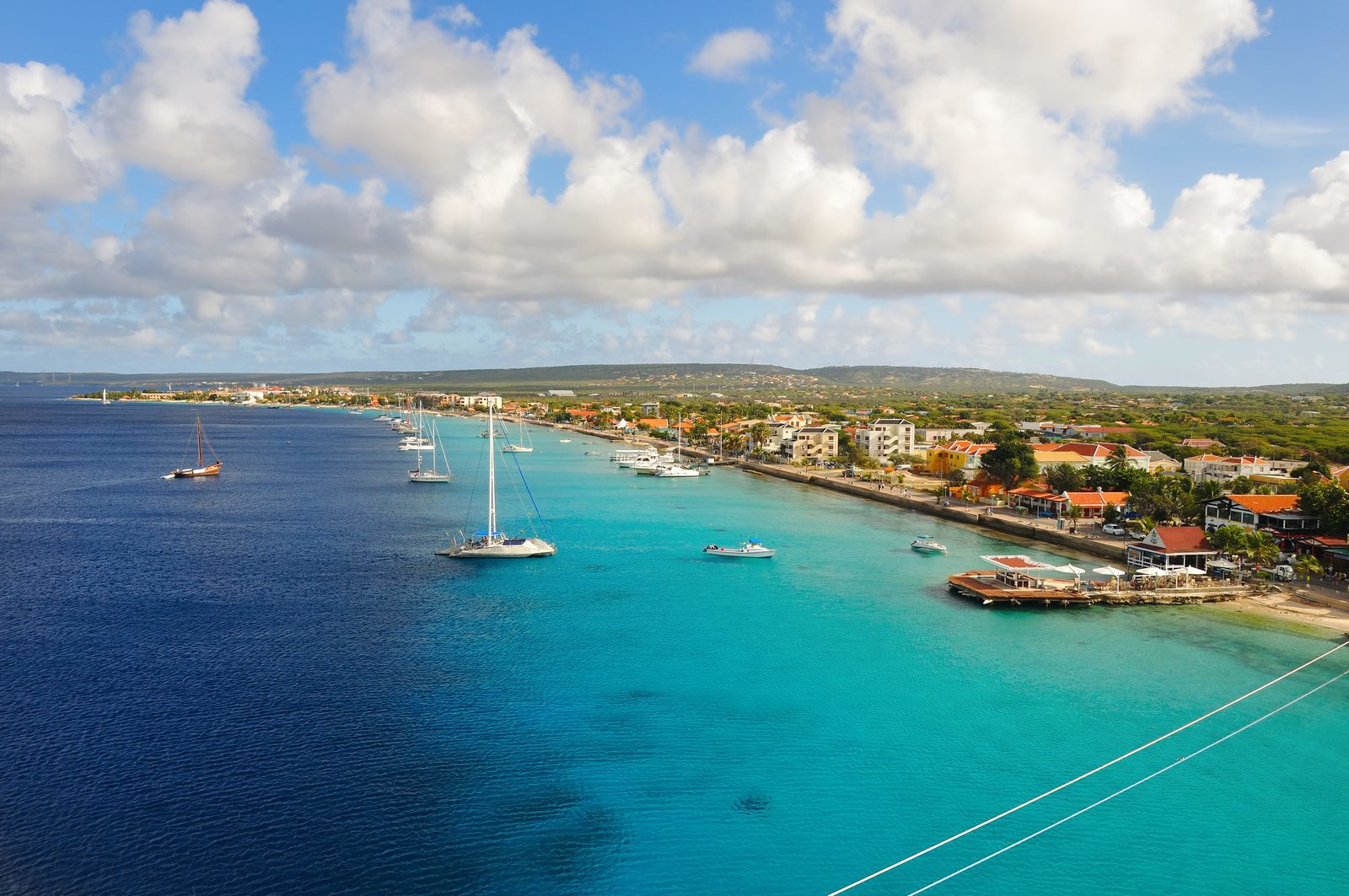 Choose a Bonaire vacation if you want to have a nice and warm vacation at a tropical island. Enjoy the snow-white beaches and pure blue water