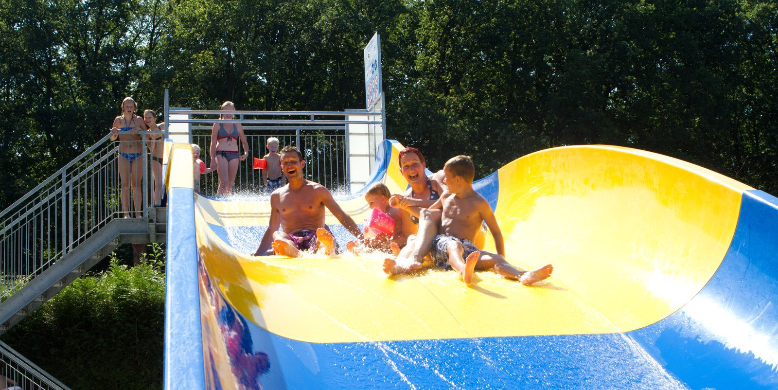 Down the awesome water slide with the whole family