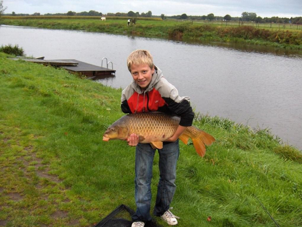Little boy with fish
