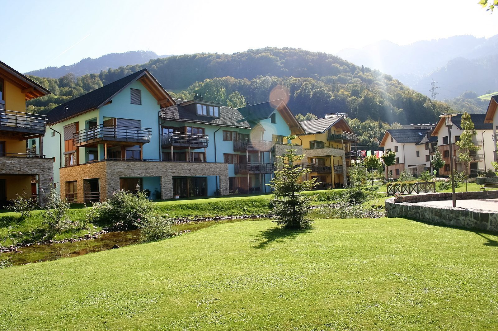 Holiday homes along the little stream of Resort Walensee in Heidiland Flumserberg Switzerland, during the Easter holidays