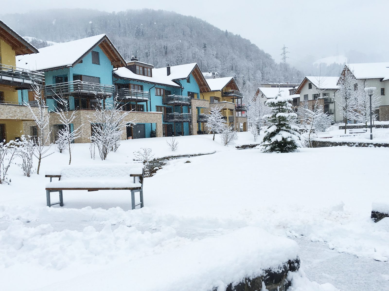 The village square of Resort Walensee in the region of Heidiland, Switzerland, during a winter sports holiday on the Flumserberg