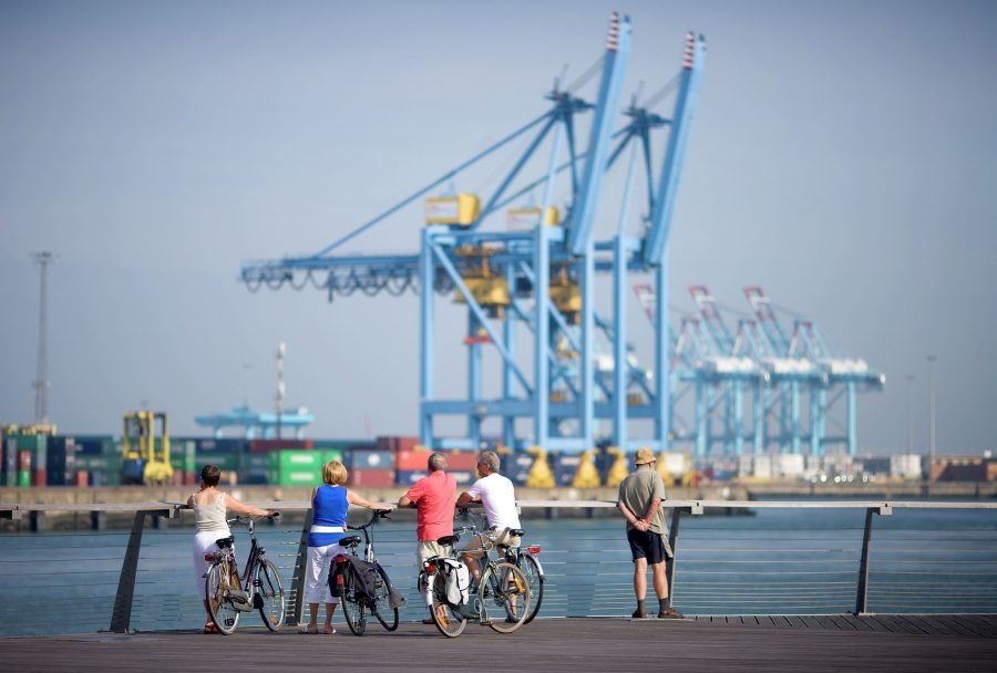Cycling along the harbor of Zeebrugge