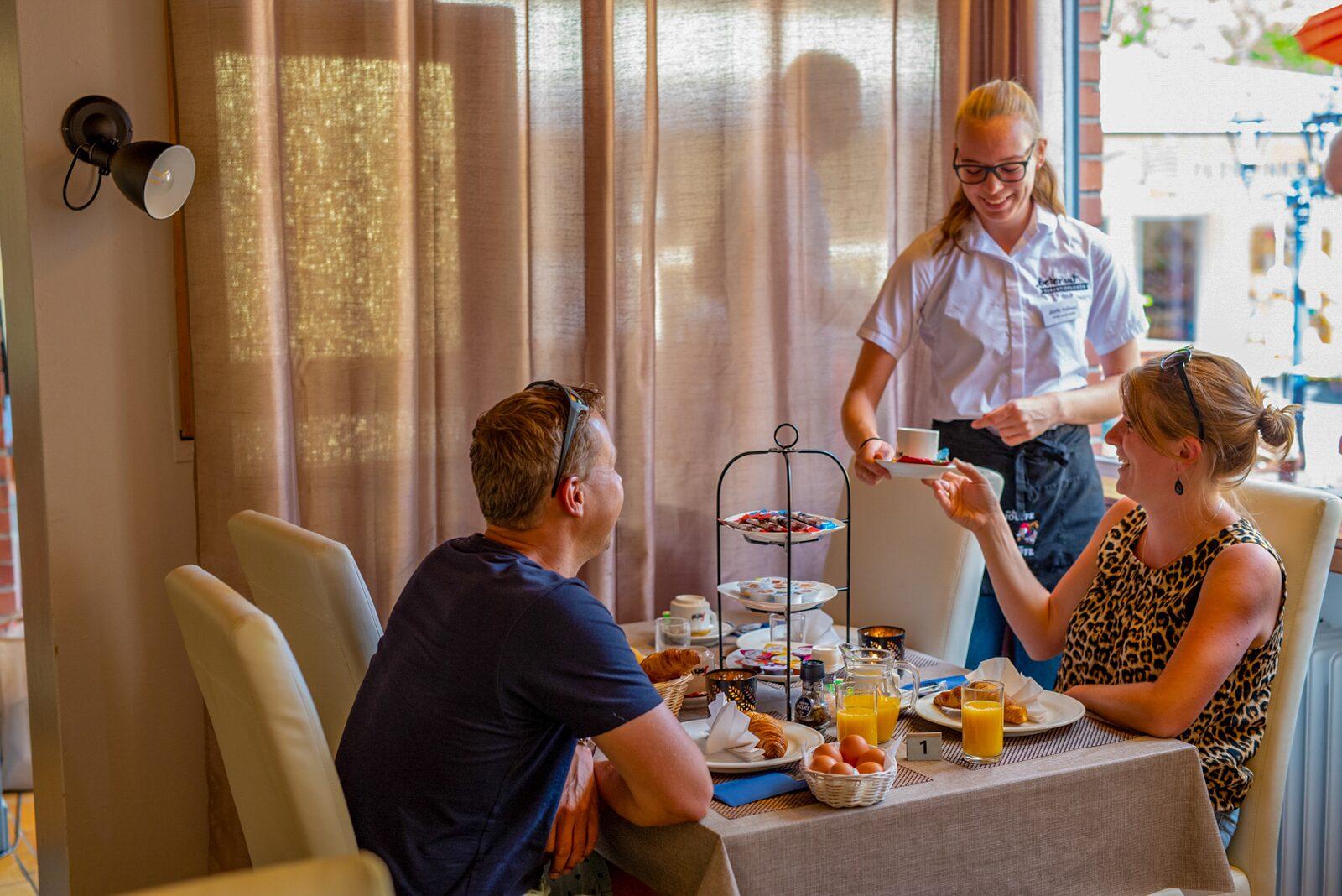 Breakfast people and waitress restaurant Walsdorf