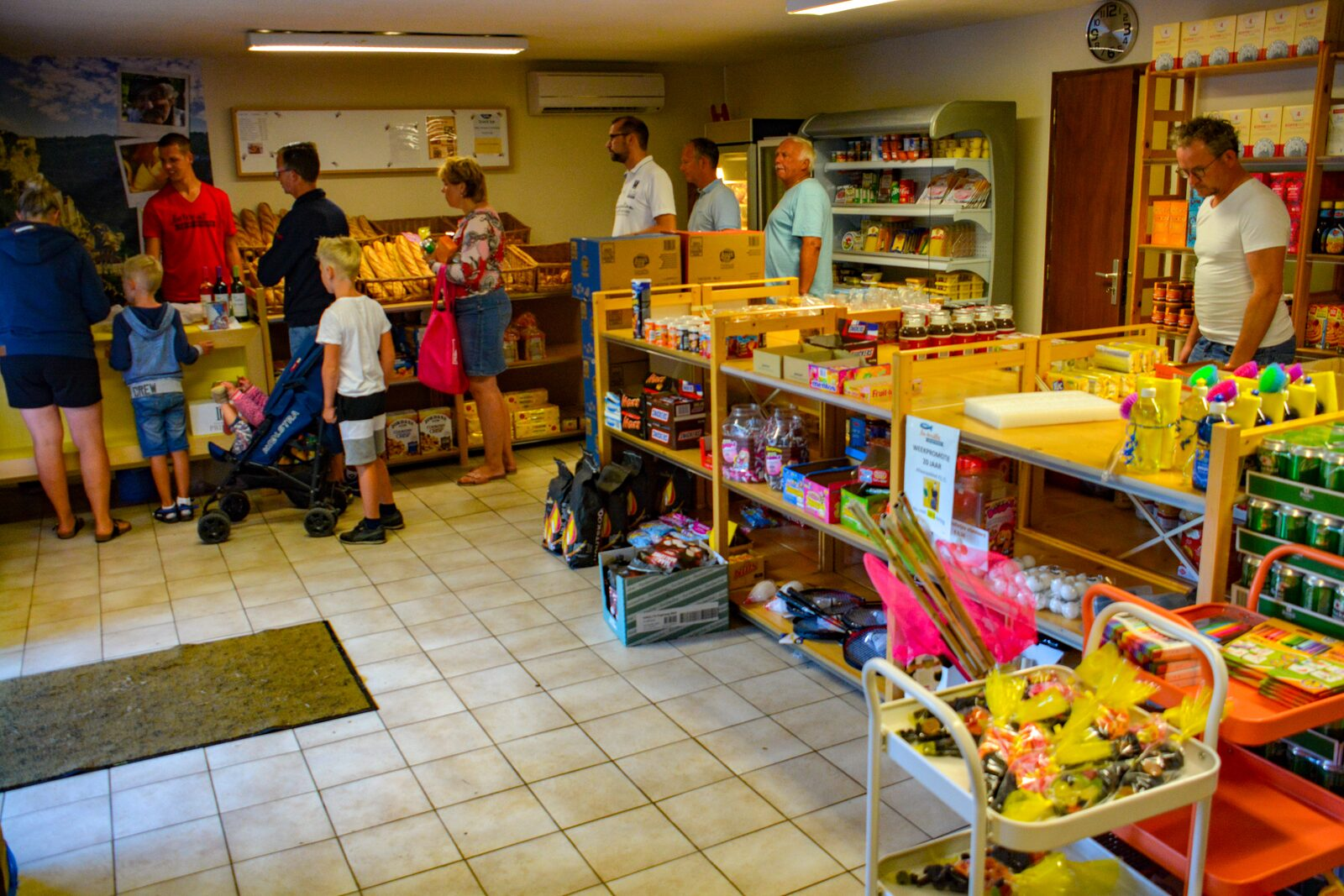 Park shop with customers at the checkout